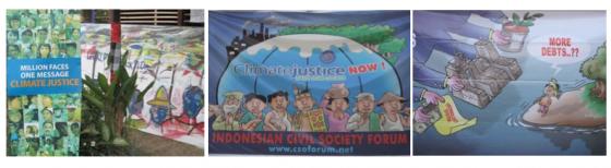Julisteita ja kuvia kokousalueen ulkopuolella sijaitsevasta kansalasijärjestöjen infoalueesta
